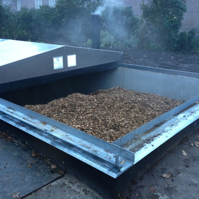 Retractable roof for covering biomass